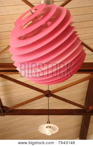 Pink modern lamp on the ceiling