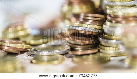 European Currency stacked Coins on Banknotes (close-up shot) poster