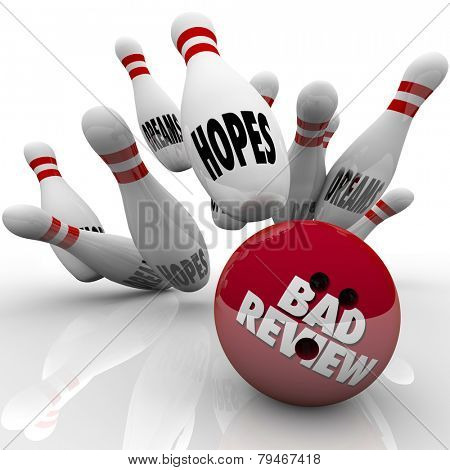 Bad Review words on a bowling ball striking pins marked with hopes and dreams to illustrate poor performance comments or feedback