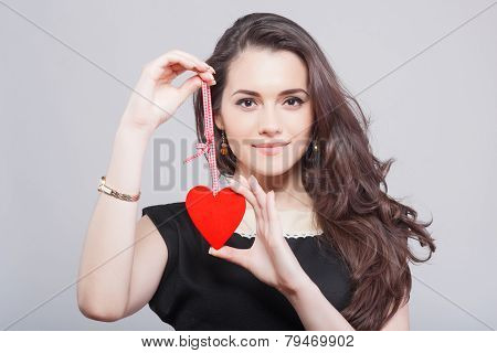 Love and valentines day woman holding heart smiling cute and adorable