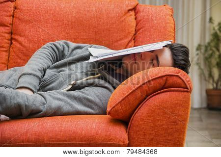 Young man at home sleeping instead of working or studying