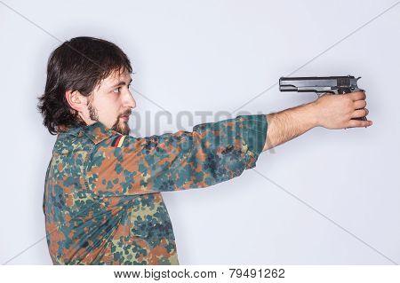 Man Pointing A Gun To His Head