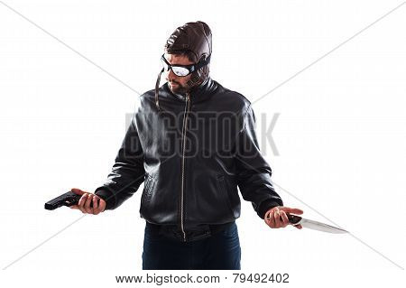 Hesitant assassin dressed as a pilot is choosing his weapon for the next crime holding a gun and a knife in his hands - isolated on white poster