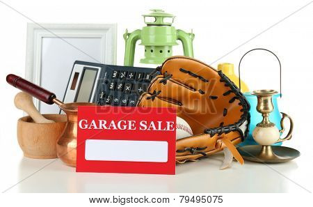 Unwanted things ready for a garage sale, isolated on white poster