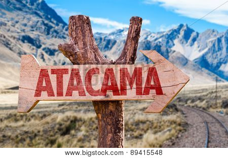 Atacama wooden sign with Cordillera background