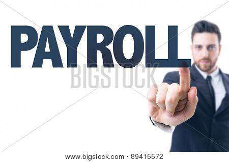 Business man pointing the text: Payroll