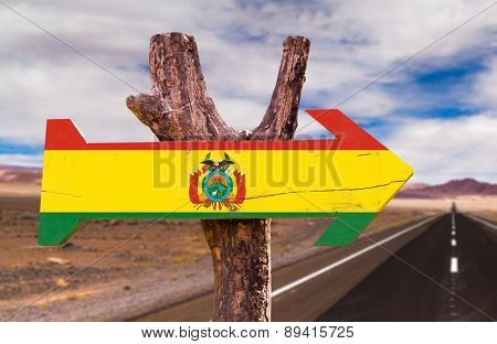 Bolivia Flag wooden sign with Valle de la Luna background