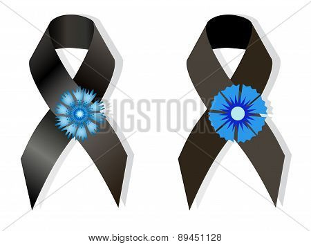 Black Awareness Ribbon And The Flower Cornflower