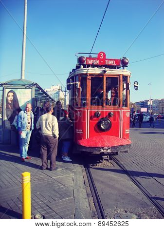 ISTANBUL, TURKEY - December 1: Old tram at Istiklal Avenue in Istanbul, Turkey on December, 2015.The Taksim Tunel Nostalgia Tram trundles along the istiklal street.