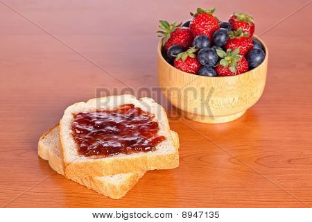 Two Toast With Jam, Blueberries And Strawberries