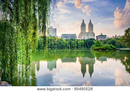 New York City, USA at the Central Park Lake and Upper West Side skyline.