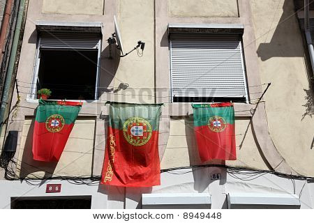 Portuguese Flags At A House