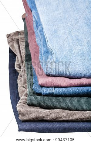 Stack Of Various Jeans And Corduroys Close Up