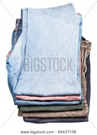Top View Of Stack Of Various Jeans And Corduroys
