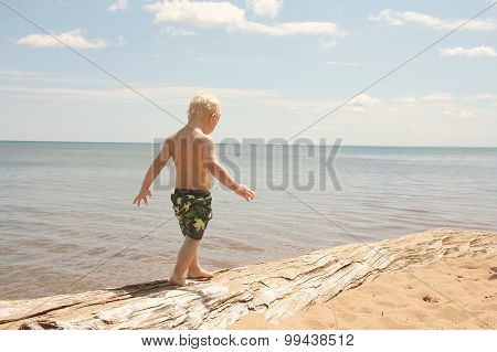 Young Child Walking On Beach