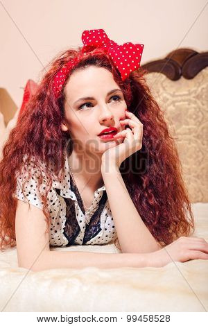 Sad red head lady  with beautiful long wavy hair