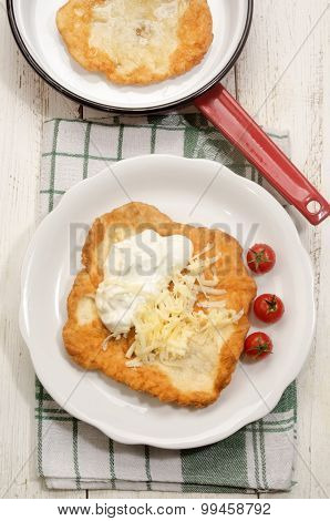 Hungarian Langos With Sour Cream And Cheese