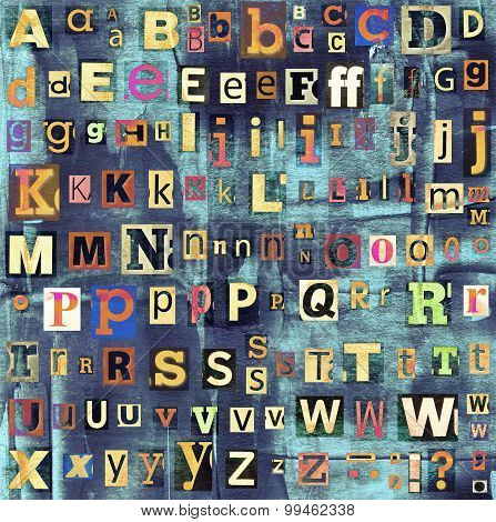Colorful grunge newspaper, magazine collage letters background