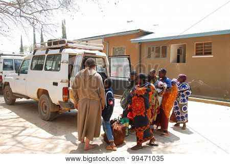 August 25 2014 Ipamba Hospital of Iringa -Tanzania -Africa -An unidentified Franciscan Friar leads an unidentified group of people to the village of Pomerini (60 km of dirt road) after medical checks carried out at the hospital