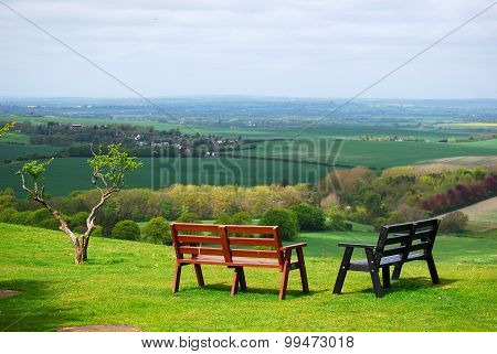 tranquilly: benches overlooking the valley from the hill