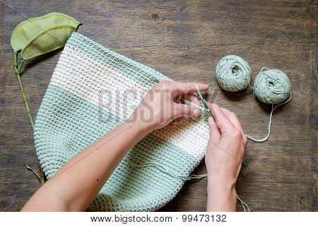 Hand Knitting Crochet Bag On A Wooden Table