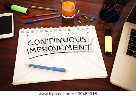 Continuous Improvement - handwritten text in a notebook on a desk - 3d render illustration. poster