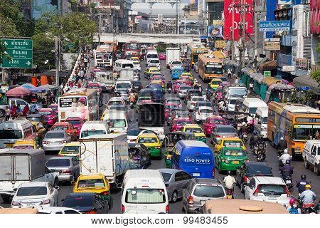 Traffic Moves Slowly Along A Busy Road In Bangkok, Thailand.