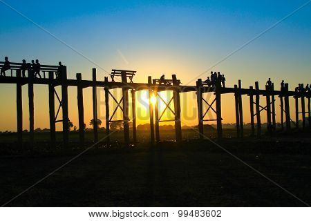 MANDALAY : Unidentified people walk on U-Bein bridge, Mandalay, Myanmar. The U-Bein bridge is the lo