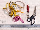 dressmaking still life - top view of cutting table with pattern and tailoring tools poster