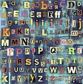 Colorful grunge newspaper, magazine collage letters background. poster