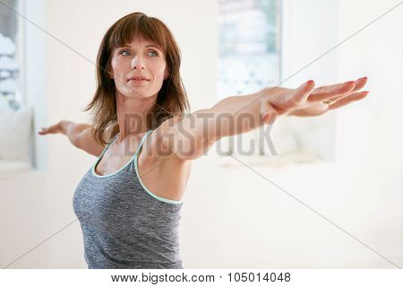 Woman Performing Yoga In Warrior Pose