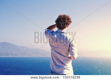 Tourist Looking Into The Distance On Blue Sea