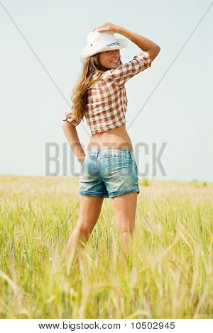 Girl  In Hat At Cereals Field