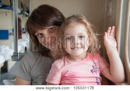 Young Girl With A Baby Sitting On The Side A Place In The Second-class Train Carriage