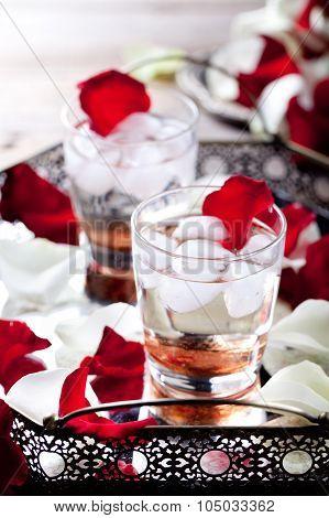 Rose flavor cocktail petals on a vintage tray