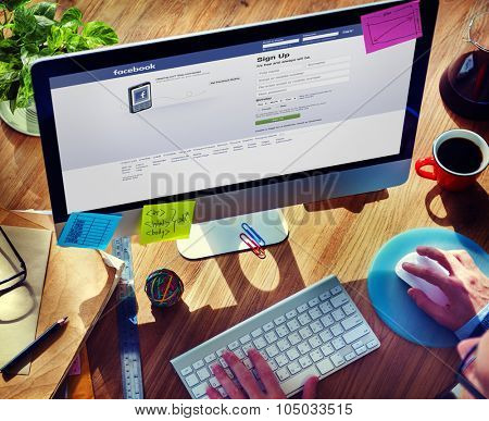 Bangkok, Thailand - October 14, 2015: Man Using Computer Browsing Facebook Website