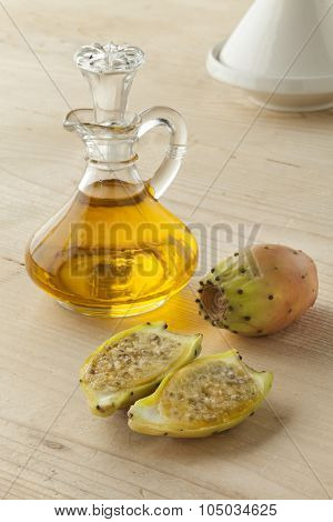 Bottle of prickly pear seed oil and prickly pears on white background poster