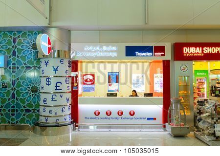 DUBAI, UAE - APRIL 18, 2014: Dubai international Airport interior. Dubai Airport is the primary airport serving Dubai and is the world's busiest airport by international passenger traffic