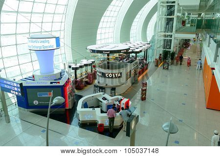 DUBAI, UAE - APRIL 18, 2014: the interior of Concourse A. The concourse includes one 4 star hotel and one 5 star hotel, first and business class lounges, and duty-free areas