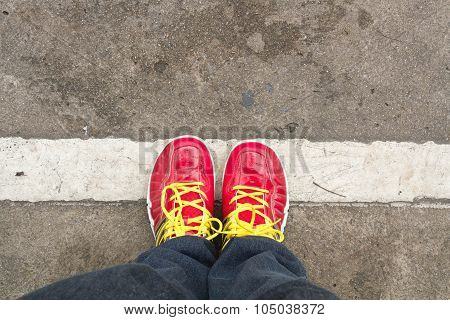 Feet Concept With Red Shoes On The Rode With Space For Text Or Symbol