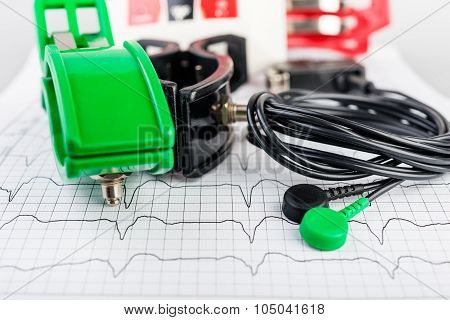 ECG electrodes  on the background of the electrocardiogram