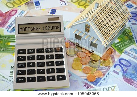 The Words -mortgage Lending On Calculator Display