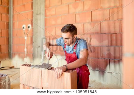 Construction Worker Builing Brick Walls, Contractor Renovating House. Construction Industry Details