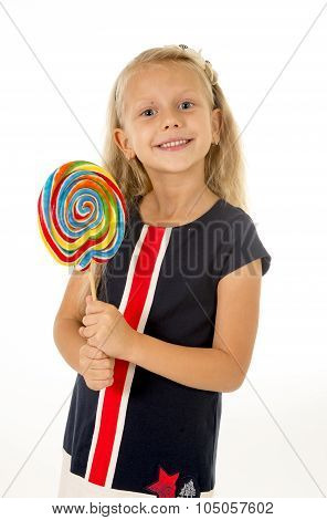 beautiful female child with long blond hair and blue eyes holding huge spiral lollipop candy smiling happy and excited eating and licking isolated on white background in sugar and sweet concept poster