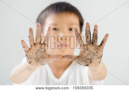 Boy with dirty hand