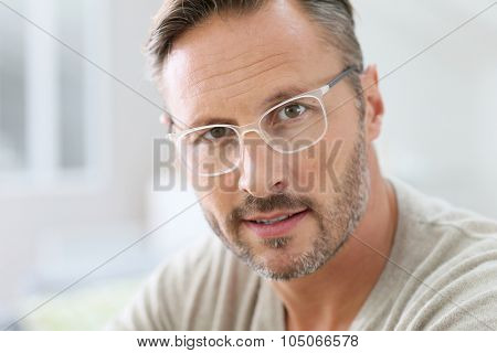 Portrait of handsome 40-year-old man with eyeglasses