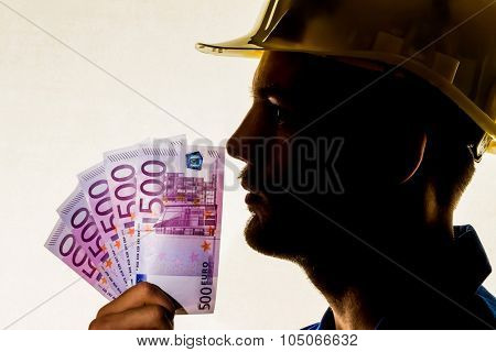 a worker in a business enterprise (craftsmen) with money bills in his hand poster