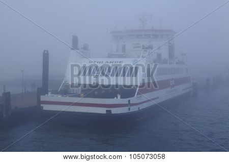 WYK GERMANY - OCTOBER 3. The ferry Uthlande lays in the port of Wyk (Foehr) at the foggy morning on October 3 2015. poster