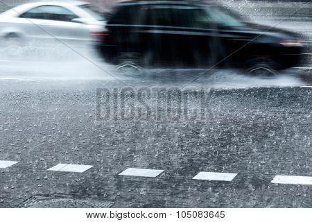 Blurred Cars In Torrential Rain