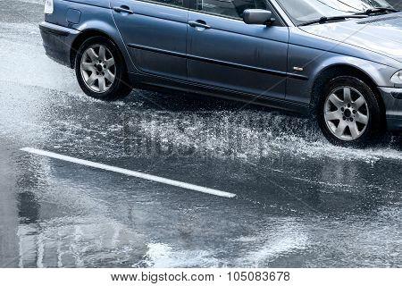 Car Rides In Rain On Flooded Street